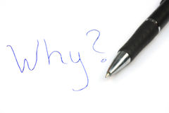Why?. Written on the paper WHY? and pen next to it stock photo
