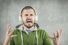 Why again the same song. Young man Royalty Free Stock Photography