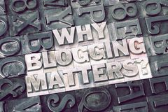 Why blogging matters. Question made from metallic letterpress blocks with dark letters background royalty free stock photography