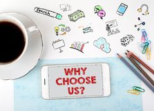 Why Choose Us. Mobile phone and coffee cup on a white office desk.  stock photos