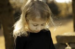 Why So Downcast. Sad little girl, looking down Stock Images
