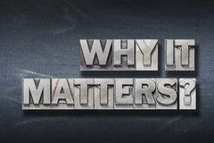 Why it matters den. Why it matters question made from metallic letterpress on dark jeans background royalty free stock photography