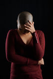 Why me. Upset desperate woman suffering from cancer, isolated on black Stock Photos