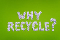 Why recycle. Question made from shredded paper on green background Stock Images