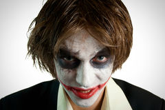 Why so serious?. Closeup portrait of young joker royalty free stock image