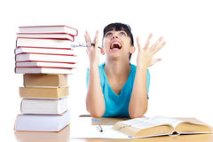 Why is studying so hard ?. Angry student screaming stressfully and holding glasses while studying isolated on white - part of a series Royalty Free Stock Photo