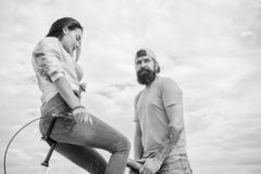 Why women more attracted biker guys. Girl sit on handlebar of his bike. Man bearded hipster rides girlfriend on his bike. Women pay attention to bikers. Girl royalty free stock image