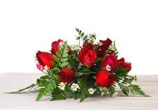 Wiązka, czerwone róże na białym tle fotografia royalty free
