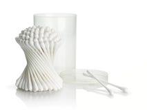 Bawełna pączki i plastikowy kocowanie na białym tle Obrazy Stock