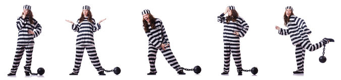 Więzień w pasiastym mundurze na bielu Obrazy Stock