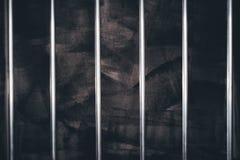 Więzienie bary, pusta ciemna cela więzienna obrazy stock