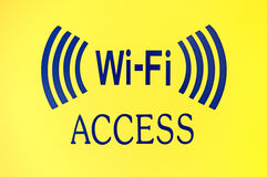 Wi-Fi Access sign. A bold Wi-Fi Access sign on a bright yellow background Royalty Free Stock Photography