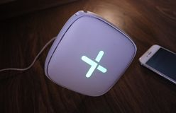 Wi-Fi adapter for home in a beautiful interior. Used to distribute the Internet at home stock image
