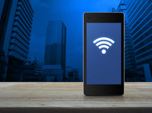 Wi-fi connection icon on modern smart phone screen on wooden tab Royalty Free Stock Photography