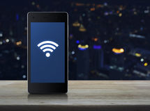 Wi-fi connection icon on modern smart phone screen Royalty Free Stock Photo