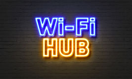 Wi-fi hub neon sign on brick wall background. Stock Photos