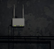 Wi-Fi router on an old wall in a dark room - background Royalty Free Stock Photos