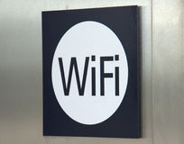Wi-Fi sign. Wi-Fi or WiFi sign on metal wall Stock Photos