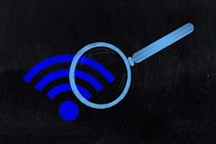 Wi-fi symbol being analysed by magnifying glass. Searching for a connection: wi-fi symbol being analysed by magnifying glass stock photos