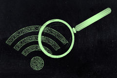 Wi-fi symbol made of microchip circuits analysed by magnifying. Searching for a connection: wi-fi symbol made of microchip circuits analysed by magnifying glass royalty free stock image