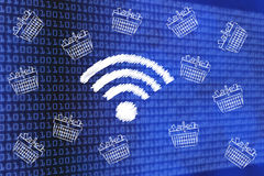Wi-fi symbol surrounded by flying shopping baskets full of item. Online shopping concept: wi-fi symbol surrounded by flying shopping baskets full of items Royalty Free Stock Images