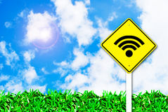 Wi-fi wireless internet sign on beautiful sky. And grass field background royalty free stock images