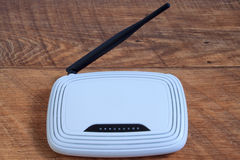 Wi-Fi wireless router on brown wooden table. Royalty Free Stock Images