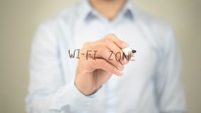 Wi-Fi Zone,  Man writing on transparent screen. High quality Stock Photography
