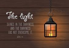 Światło błyszczy w ciemności Biblijna wycena Zdjęcia Stock