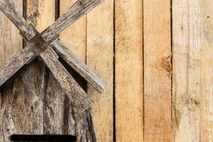 Wiatraczka i drewna deska Zdjęcia Stock