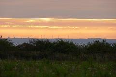 Wiatrowego gospodarstwa rolnego wschód słońca Fotografia Royalty Free