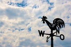 Wiatrowskaz na chmurnym niebie Obraz Royalty Free