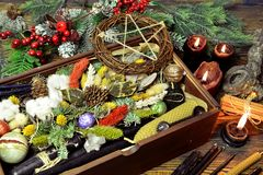 Wicca concept with box of presents, black candles, pentagram, magic healing herbs, conifer. New Year and Christmas celebration greeting card and holiday stock images