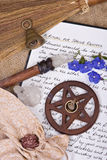 Wiccan Ritual - Spring Equinox. Wooden pentacle with incense burning with hand written book of shadows and flowers - spring equinox ritual Royalty Free Stock Photos