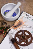 Wiccan Ritual Tools. Wiccan tools on top of book of shadows with wand bell and pentacle incense burner Royalty Free Stock Photos