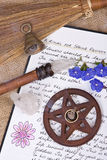 Wiccan Spring Ritual - Book Of Shadows. Wooden pentacle with incense burning with hand written book of shadows and flowers - spring equinox ritual Royalty Free Stock Photography