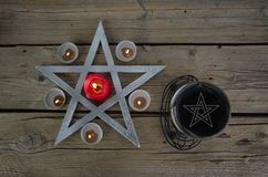 Wiccan symbols for divination ritual. Crystal ball and pentagram stock photography