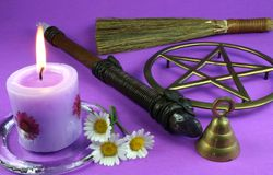 Wiccan Tools. Candles, flowers, wand, bell, pentacle and besom Royalty Free Stock Photography