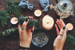 Free Wiccan Witch Holding Cedar Cleansing Stick To Cleanse The Energy At Her Altar Stock Image - 192862191