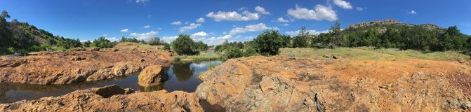 Wichita Mountains Wildlife Refuge Panorama. A panoramic view of the wildlife sanctuary covering nearly 60,000 acres of Oklahoma. Bison, longhorn cattle, and Stock Photo