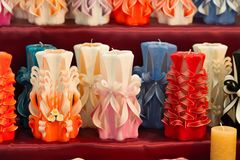 Wick, paraffin or wax od various colors, decor. Candles on shelf in decoration shop. Decor design, craft, decoration shop. Sale shop, shopping royalty free stock images