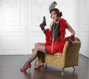 Wicked and armed beautiful woman Royalty Free Stock Image