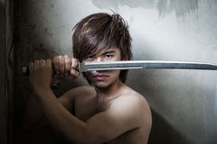 Wicked Asian man with sword of justice stock photo