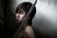 Wicked Asian man with sword of justice Royalty Free Stock Image