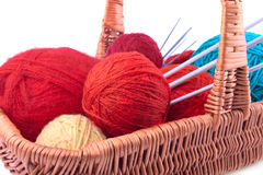Wicked basket with yarn and needles Stock Images