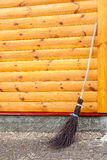 Wicked broom by wall Stock Photos