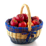 Wicked cane basket apples Stock Photography