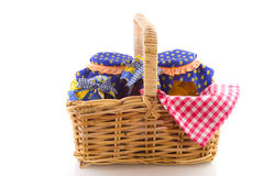 Wicked cane picnic basket. With pots food Royalty Free Stock Photography