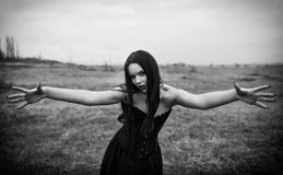 Wicked dangerous goth girl in autumnal field. Black and white Royalty Free Stock Photos