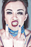 Wicked girl showing middle finger Royalty Free Stock Images